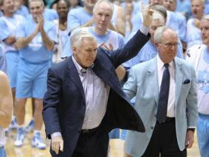 Dean Smith waves to an appreciative crowd during the Celebration of the Century at UNC's Dean E. Smith Center, Friday, February 12, 2010. Photo by Todd Melet.
