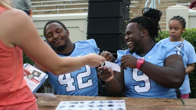 "#42 Robert Quinn and #9 Marvin Austin at the ""Meet the Heels"" autographing event at Kenan Stadium on Saturday, Aug. 28. (photo by Will Okun)"