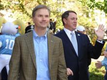 UNC Chancellor Holden Thorp (left) and head coach Butch Davis (right) greet fans during the Well Walk before the North Carolina Tar Heels vs. William & Mary Tribe game inside Kenan Stadium in Chapel Hill, N.C. on Saturday, October 30, 2010.