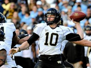 Wake Forest Demon Deacons quarterback Tanner Price (10) drops back to pass.