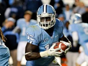 North Carolina Tar Heels linebacker A.J. Blue (15) carries the ball around the end.North Carolina defeats Wake Forest 49-24 at Kenan Stadium in Chapel Hill North Carolina.