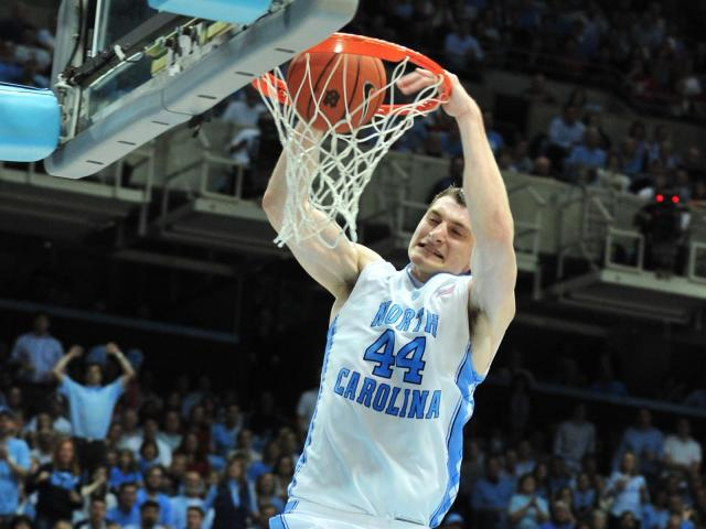 Tyler Zeller (44) dunks during the North Carolina Tar Heels vs. North Carolina State Wolfpack NCAA basketball game in Chapel Hill, N.C. Thursday, January 26, 2012.<br/>Photographer: Will Bratton
