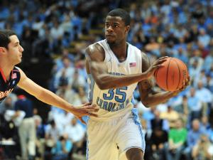 Reggie Bullock (35) looks to make a pass during the North Carolina Tar Heels vs. Virginia Cavaliers NCAA basketball game in Chapel Hill, N.C. Saturday, February 11, 2012.
