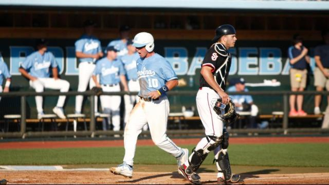 Brian Holberton scores a run during the St. John's vs. UNC regional game on June 3, 2012 in Chapel Hill, NC.