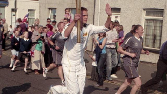 Joe Hutchinson ran a leg of the Olympc torch relay in May.