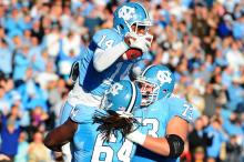 Quinshad Davis (14) celebrates a touchdown with Jonathan Cooper (64) and James Hurst (73) during the North Carolina Tar Heels vs. Maryland Terrapins NCAA football game, Saturday, November 24, 2012 in Chapel Hill, NC.