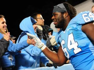 Senior offensive guard Jonathan Cooper (64) and UNC senior Lilliann Vigil (left) following the North Carolina Tar Heels vs. Maryland Terrapins NCAA football game, Saturday, November 24, 2012 in Chapel Hill, NC.