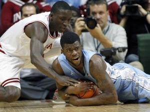 North Carolina Tar Heels guard Reggie Bullock (35) tries to keep this loose ball from Indiana Hoosiers guard Victor Oladipo (4) in second half action. The North Carolina Tar Heels traveled to Bloomington, IN to take on the Indiana Hoosiers in Assembly Hall on Tuesday, November 27, 2012. Indiana won the game 83-59.