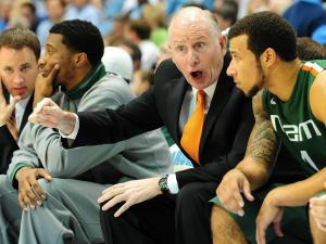 Miami head coach Jim Larranaga speaks with a player during the North Carolina Tar Heels vs. Miami Hurricanes NCAA basketball game, Thursday, January 10, 2013 in Chapel Hill, NC.