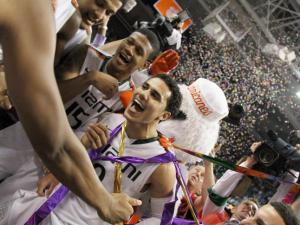 Miami's Shane Larkin and teammates following the Hurricanes' 87-77 title game victory over North Carolina in the 60th ACC Tournament on Sunday, March 17, 2013 in Greensboro, NC (Photo by Jack Morton).