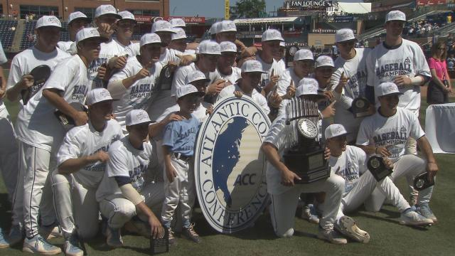 North Carolina poses with the ACC championship trophy after defeating Virginia Tech 4-1 in Sundays title game at Durham Bulls Athletic Park.