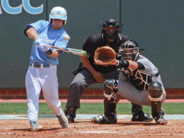 A Carolina player drives a pitch to the outfield. UNC defeats South Carolina 5-4 to advance to the College World Series Boshamer Stadium, Chapel Hill, NC, June 11,2013 (Photo by Jack Tarr)