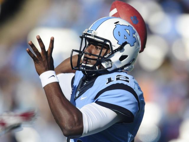 UNC quarterback Marquise Williams (12) drops back to pass during play at Kenan Stadium between the University of North Carolina Tar Heels and the Boston College Eagles on October 26, 2013 in Chapel Hill, NC.<br/>Photographer: Will Bratton