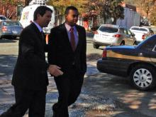 Former NC Central quarterback Michael Johnson turns himself in on charges of athlete-agent inducement Wednesday, Nov. 13, 2013.