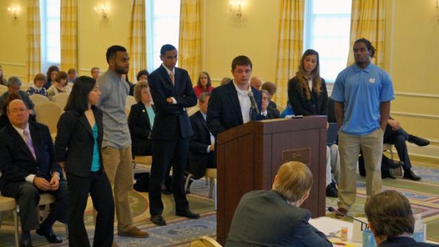 Six student-athletes address the University of North Carolina Board of Trustees on Thursday, March 27, 2014.