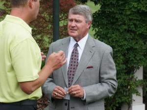 ACC commissioner John Swofford talks to WRAL's Jeff Gravley on the first day of the ACC Football Kickoff at the Grandover in Greensboro, July 20, 2014.
