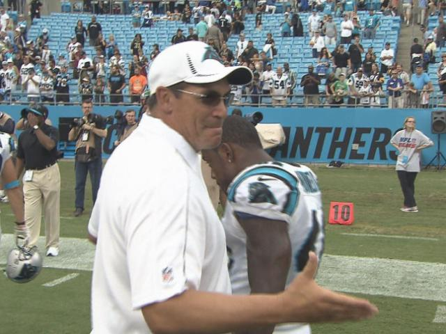 Panthers head coach Ron Rivera congratulates players following the Panthers vs. Saints game at Bank of America Stadium Sunday, Sept. 16.