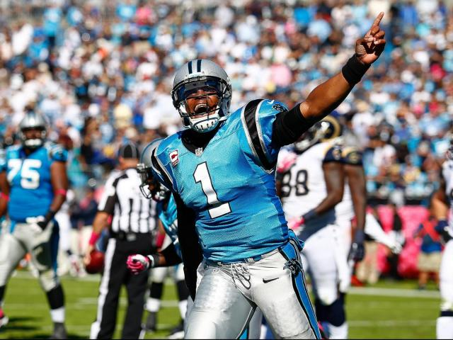 Carolina Panthers quarterback Cam Newton (1) celebrates the Panthers TD. St. Louis Rams visiting the Carolina Panthers on Sunday October 20, 2013. Rams first play from scrimmage was intercepted and returned for a TD and the Panthers never looked back with a hime victory of 30-15. Photo by CHRIS BAIRD<br/>Photographer: Chris Baird