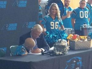 Panthers sign 6-year-old coach