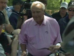 Arnold Palmer hits the golf course