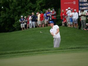 Webb Simpson chips out of the ruff during the  second round of Wells Fargo championship play at Quail Hollow, Friday, May 2, 2014.