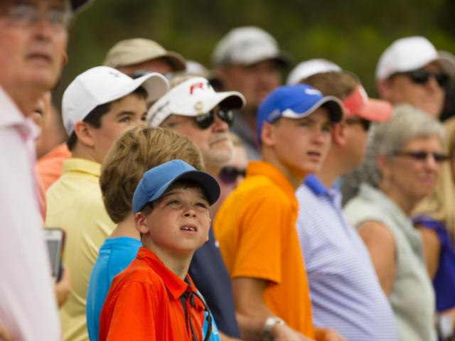 The gallery watches the action during a practice round before the 2014 U.S. Open at Pinehurst Resort & C.C. in Village of Pinehurst, N.C. on Monday, June 9, 2014. (Copyright USGA/Fred Vuich)