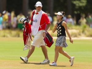 Lucy Li and her caddie Bryan Bush walk up the first hole during the second round at the 2014 U.S. Women's Open at Pinehurst Resort & C.C. in Village of Pinehurst, N.C. on Friday, June 20, 2014.  (Copyright USGA/Matt Sullivan)