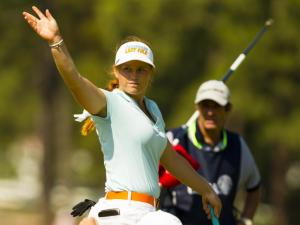 Hannah Pietila waves after making a putt on the 13th hole during the first round at the 2014 U.S. Women's Open at Pinehurst Resort & C.C. in Village of Pinehurst, N.C. on Thursday, June 19, 2014.  (Copyright USGA/Matt Sullivan)