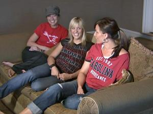 Wives of the Hurricanes players celebrate and commiserate. From left: Katie Eaves, Becky Bayda and Brijet Whitney prepare to watch a game played in Pittsburgh.