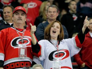 Carolina Hurricane fans get excited during tonights game.Hurricanes defeat the Bruins 3-2 at the RBC Center, in Raleigh NC.