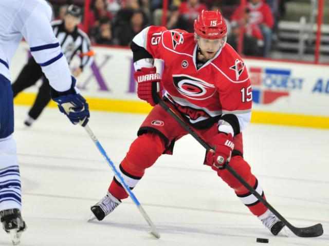 Tuomo Ruutu (15) looks for room to skate during the Carolina Hurricanes vs. Toronto Maple Leafs game, Sunday, November 20, 2011 at the RBC Center in Raleigh, NC. <br/>Photographer: Will Bratton