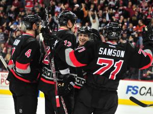 The Canes celebrate after scoring a goal during the Carolina Hurricanes vs. Washington Capitals NHL hockey game in Raleigh, N.C. Monday, February 20, 2012.