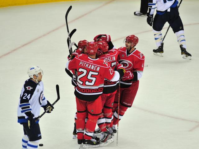 Canes players celebrate after a goal during the Carolina Hurricanes vs. Winnipeg Jets NHL hockey game in Raleigh, N.C. Friday, March 30, 2012.<br/>Photographer: Will Bratton
