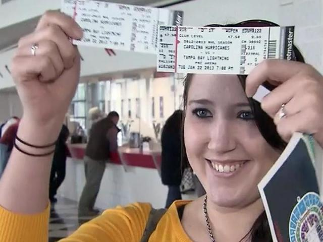 Christy Bullins proudly displays her tickets to the Carolina Hurricanes&#039; home opener on Jan. 22, 2013.<br/>Photographer: Keith Baker