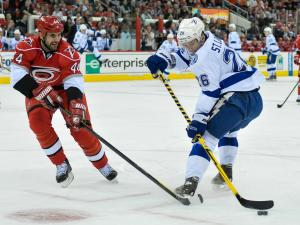 Tampa Bay Lightning right wing Martin St. Louis (26) and Carolina Hurricanes defenseman Jay Harrison (44)  during tonights game. Hurricanes vs Tampa Bay game on January 22, 2013  at PNC Arena in Raleigh North Carolina. (Photos By Anthony Barham)