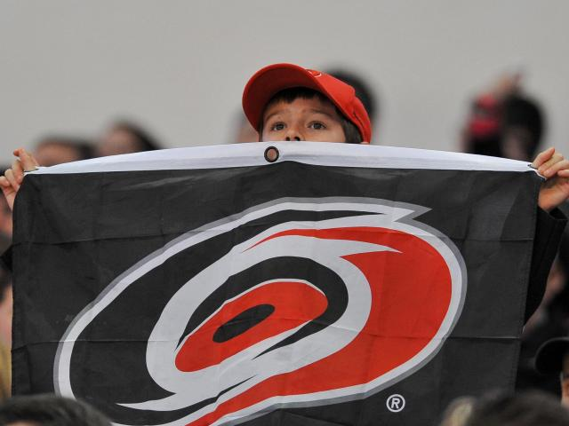 Carolina Hurricanes fans celebrate during tonights game. Hurricanes vs Tampa Bay game on January 22, 2013  at PNC Arena in Raleigh North Carolina. (Photos By Anthony Barham)
