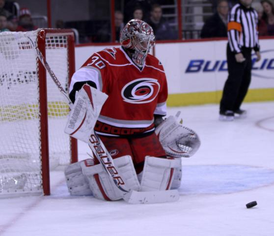 Carolina Hurricanes goalie Cam Ward (30) blocks a shot during the game Thursday January 24, 2013. (Photo by Jack Tarr)