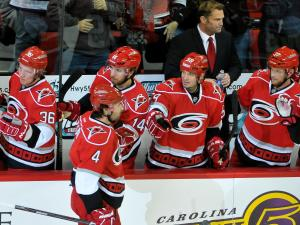 Carolina Hurricanes celebrate at the bench after scoring during the Hurricanes vs Ottawa Senators game on February  01, 2013  in Raleigh North Carolina. (Photos By Anthony Barham)
