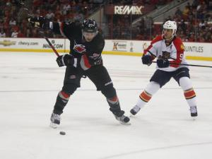Justin Faulk (27) prepares to shoot during the Panthers vs. Hurricanes game on March 2, 2013 in Raleigh, NC.