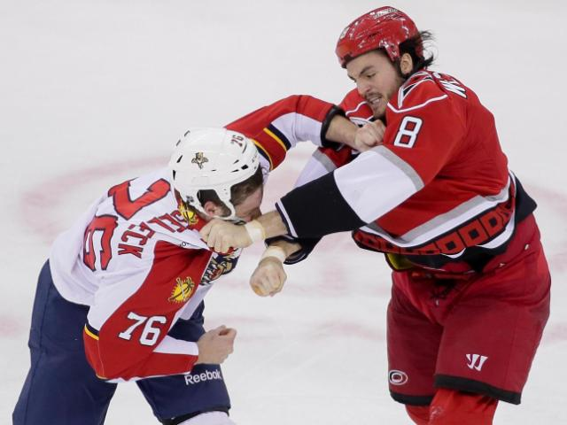 Carolina Hurricanes right wing Kevin Westgarth (8) and Florida Panthers defenseman Dmitry Kulikov (7) throw punches during the Hurricanes vs Panthers game on March 19, 2013  in Raleigh North Carolina. (Photos By Anthony Barham)