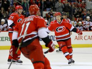 Carolina Hurricanes center Jeff Skinner (53) celebrates a goal as the Devils defeated the Hurricanes 4 to 1 at PNC Arena in Raleigh, NC Thursday March 21, 2013 (Photo by Jack Tarr)