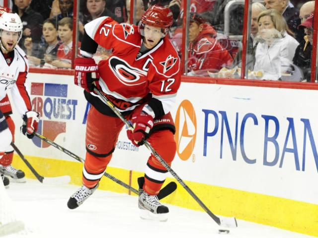 Eric Staal (12) skates with the puck during the Carolina Hurricanes vs. Washington Capitals NHL hockey game, Tuesday, April 2, 2013 in Raleigh, NC. <br/>Photographer: Will Bratton