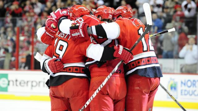 FILE: The Carolina Hurricanes celebrate after a first period goal during the Carolina Hurricanes vs. Washington Capitals NHL hockey game, Tuesday, April 2, 2013 in Raleigh, NC.