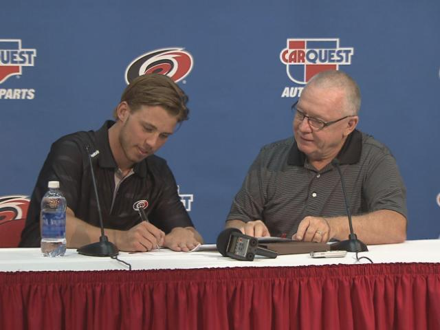 Carolina Hurricanes top draft pick Elias Lindholm signed a three-year, entry-level contract Monday that will pay him $832,500 annually at the NHL level.
