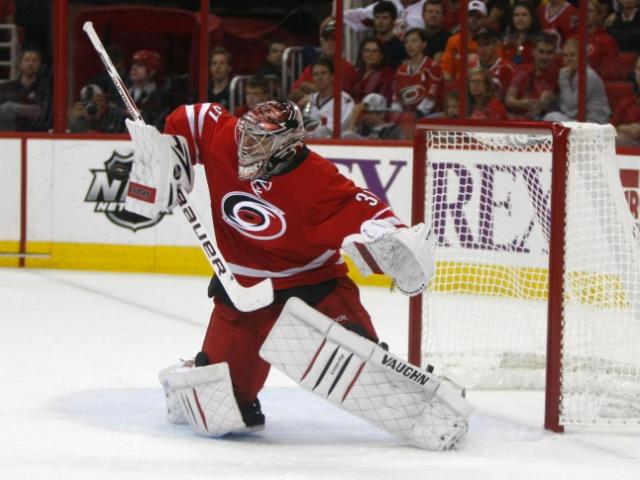 Anton Khudobin (31) makes a save during the Flyers vs. Hurricanes game on October 6, 2013 in Raleigh, NC.<br/>Photographer: Jerome Carpenter