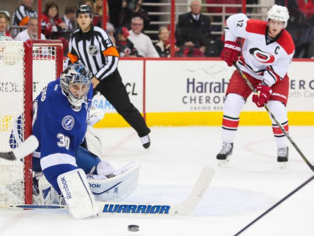 Tampa Bay Lightning goalie Ben Bishop (30) with a nice save during the Hurricanes' 3-0 home loss to the Lightnings at PNC Arena on November 1, 2013 in Raleigh, NC (Photos By Anthony Barham)
