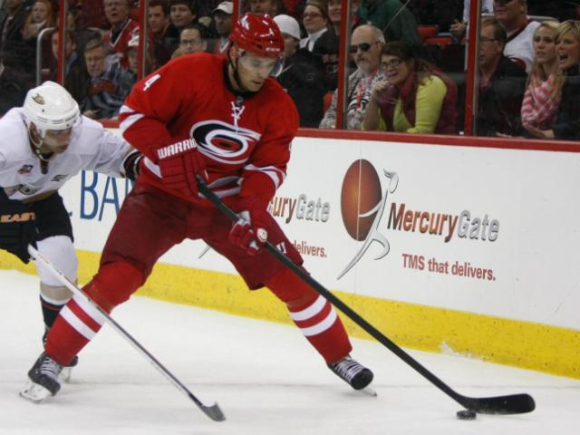 Andrej Sekera (4) controls the puck.The Hurricanes hosted the Ducks on November 15, 2013  at the PNC Center in Raleigh, North Carolina.<br/>Photographer: Jerome Carpenter