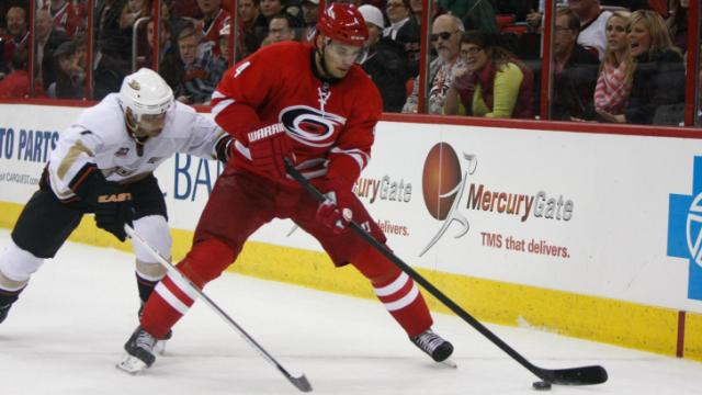 Andrej Sekera (4) controls the puck.The Hurricanes hosted the Ducks on November 15, 2013  at the PNC Center in Raleigh, North Carolina.