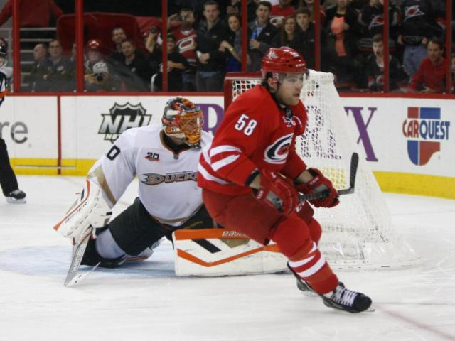 Chris Terry (58) scores against Viktor Fasth (30) for the game winner. The Hurricanes hosted the Ducks on November 15, 2013  at the PNC Center in Raleigh, North Carolina.<br/>Photographer: Jerome Carpenter