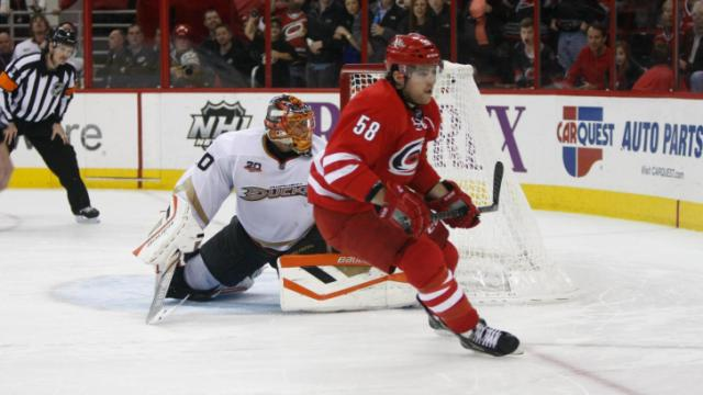 Chris Terry (58) scores against Viktor Fasth (30) for the game winner. The Hurricanes hosted the Ducks on November 15, 2013  at the PNC Center in Raleigh, North Carolina.
